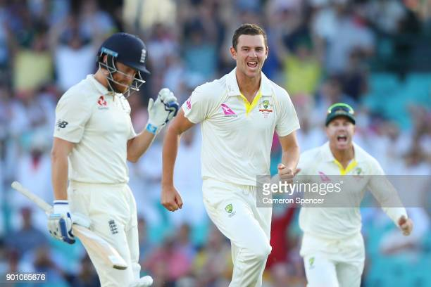 Josh Hazlewood of Australia celebrates after taking the wicket of Jonny Bairstow of England during day one of the Fifth Test match in the 2017/18...