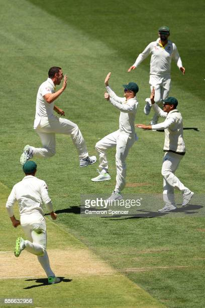 Josh Hazlewood of Australia celebrates dismissing Joe Root of England during day five of the Second Test match during the 2017/18 Ashes Series...