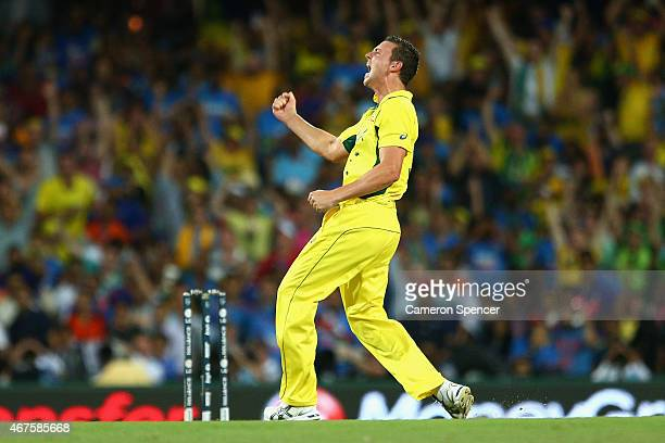 Josh Hazlewood of Australia celebrates dismissing Shikhar Dhawan of India during the 2015 Cricket World Cup Semi Final match between Australia and...