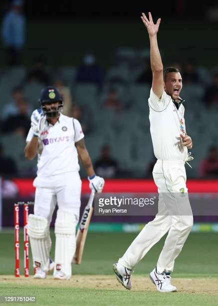 Josh Hazlewood of Australia celebrates taking the LBW wicket of Hanuma Vihari of India for 16 runs during day one of the First Test match between...