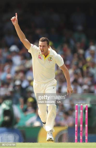 Josh Hazlewood of Australia celebrates taking the wicket of Alastair Cook of England during day one of the Fifth Test match in the 2017/18 Ashes...