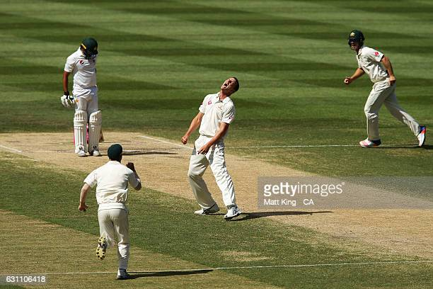 Josh Hazlewood of Australia celebrates taking the wicket of Azhar Ali of Pakistan during day five of the Third Test match between Australia and...