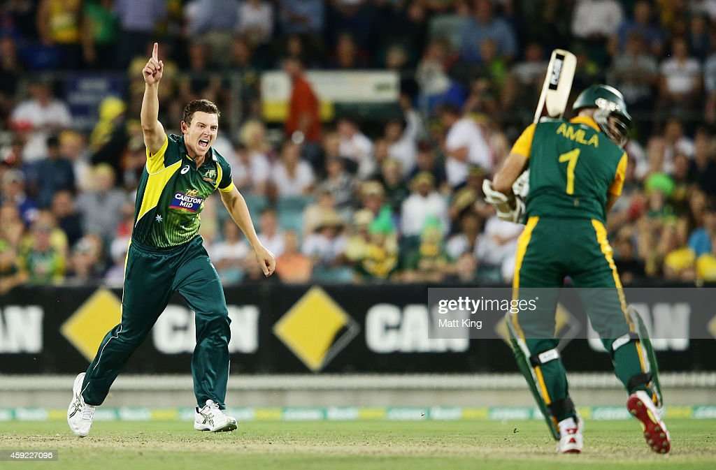 Josh Hazlewood of Australia celebrates taking the wicket of Hashim Amla of South Africa during game three of the One Day International Series between Australia and South Africa at Manuka Oval on November 19, 2014 in Canberra, Australia.