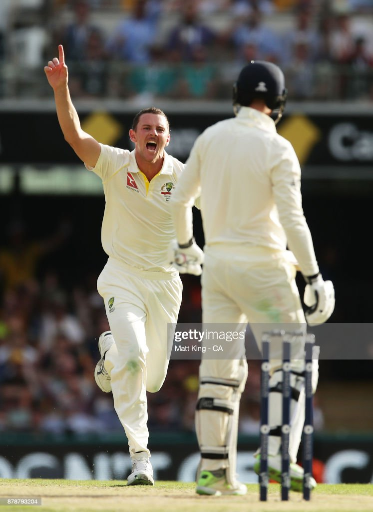 Josh Hazlewood of Australia celebrates taking the wicket of James Vince of England during day three of the First Test Match of the 2017/18 Ashes Series between Australia and England at The Gabba on November 25, 2017 in Brisbane, Australia.