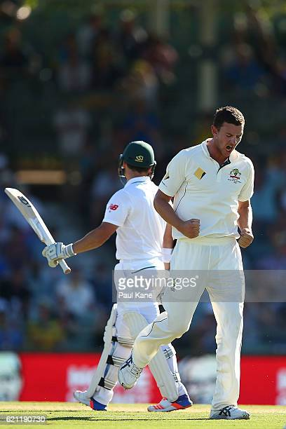 Josh Hazlewood of Australia celebrates the wicket of Dean Elgar of South Africa during day three of the First Test match between Australia and South...