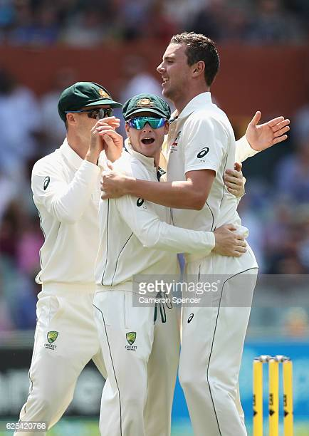 Josh Hazlewood of Australia celebrates with captain Steve Smith after dismissing JeanPaul Duminy of South Africa during day one of the Third Test...