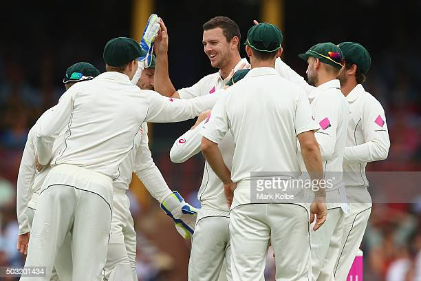 Josh Hazlewood of Australia celebrates with his team after taking the wicket of Shai Hope of West Indies during day one of the third Test match...