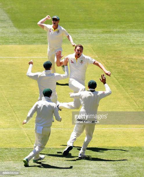 Josh Hazlewood of Australia celebrates with his team mates after taking the wicket of Joe Root of England during day five of the Second Test match...