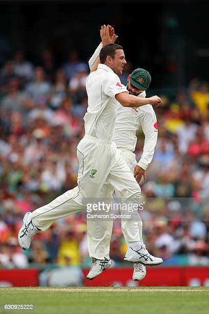 Josh Hazlewood of Australia celebrates with team mate Nathan Lyon after dismissing Babar Azam of Pakistan during day two of the Third Test match...