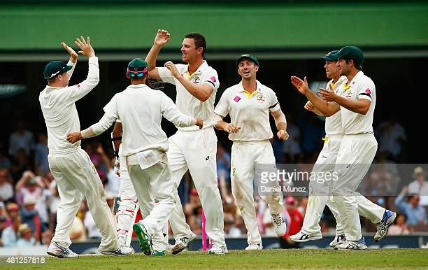 Josh Hazlewood of Australia celebrates with teammates after taking the wicket of Ravichandran Ashwin of India during day five of the Fourth Test...