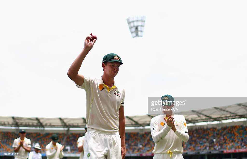 Josh Hazlewood of Australia holds up the the ball as he leaves the ground after claiming five wickets on debut during day two of the 2nd Test match between Australia and India at The Gabba on December 18, 2014 in Brisbane, Australia.