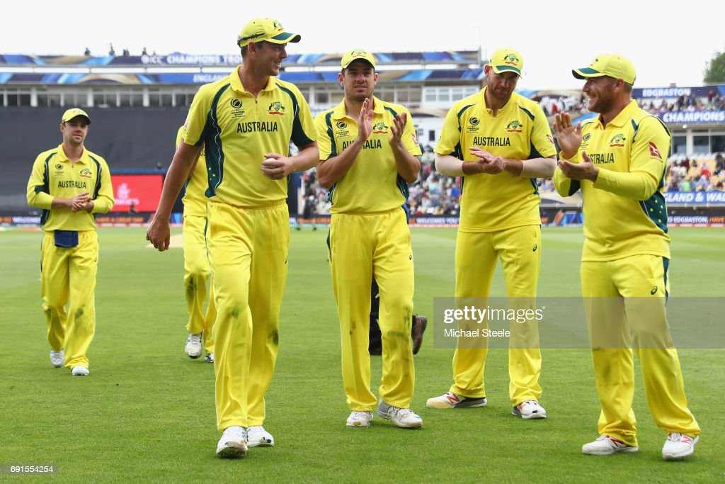 Josh Hazlewood (L) of Australia is applauded from the field by team mates after finishing with match figures of 6 for 52 during the ICC Champions Trophy match between Australia and New Zealand at Edgbaston on June 2, 2017 in Birmingham, England.