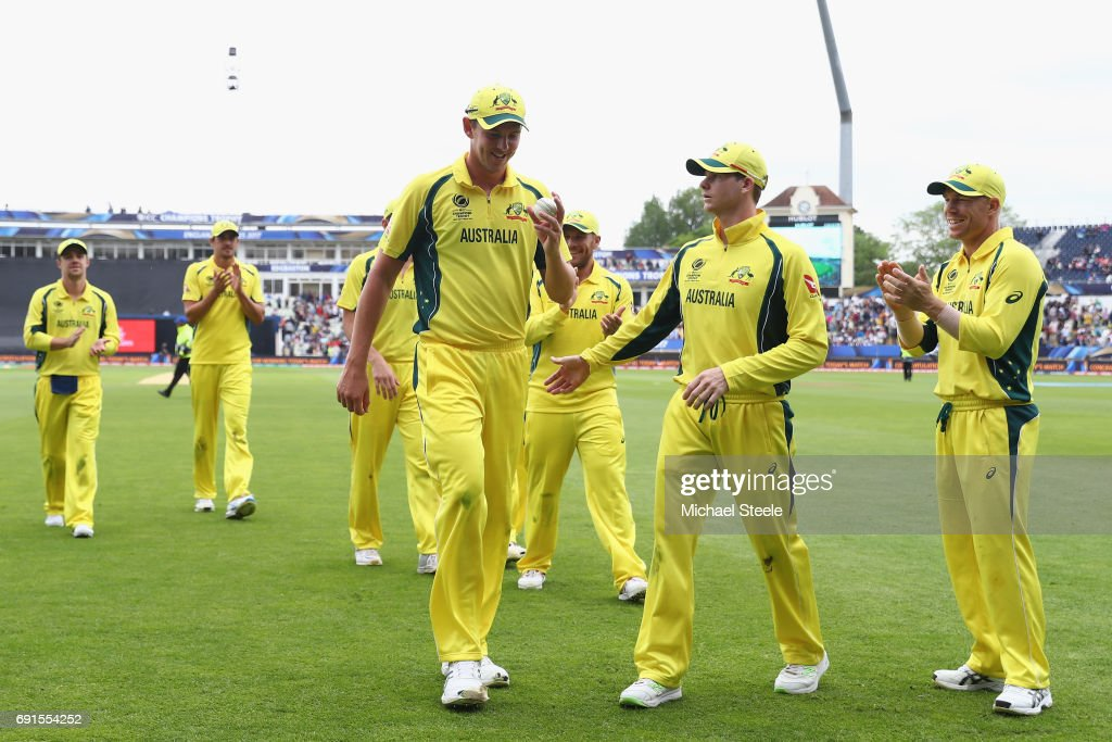 Josh Hazlewood of Australia is congratulated by captain Steve Smith (2R) after finishing with match figures of 6 for 52 during the ICC Champions Trophy match between Australia and New Zealand at Edgbaston on June 2, 2017 in Birmingham, England.
