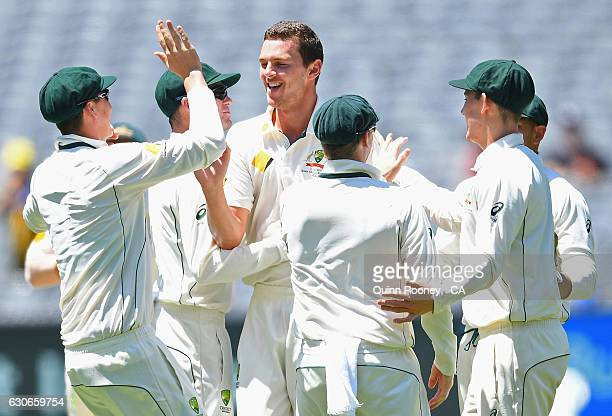 Josh Hazlewood of Australia is congratulated by his teammates after dismissing Sami Aslam of Pakistan during day five of the Second Test match...
