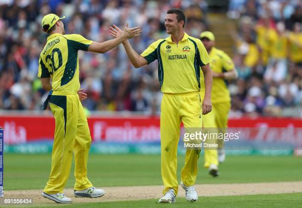 Josh Hazlewood of Australia is congratulated by Pat Cummins after capturing his fifth wicket during the ICC Champions Trophy match between Australia...