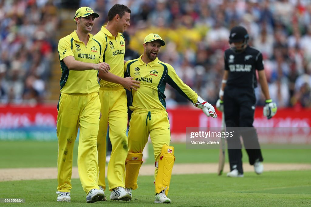 Josh Hazlewood (2L) of Australia is congratulated by Pat Cummins (L) and wicketkeeper Matthew Wade after capturing his fifth wicket during the ICC Champions Trophy match between Australia and New Zealand at Edgbaston on June 2, 2017 in Birmingham, England.