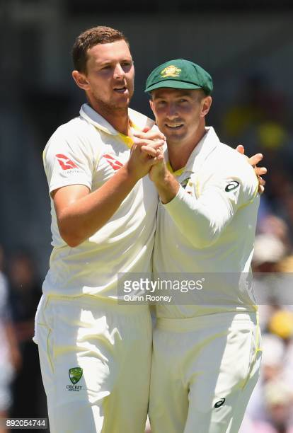 Josh Hazlewood of Australia is congratulated by Shaun Marsh after taking the wicket of James Vince of Englandduring day one of the Third Test match...