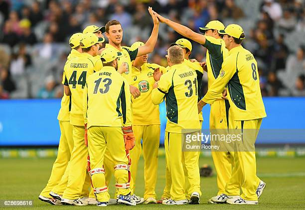 Josh Hazlewood of Australia is congratulated by team mates after dismissing Colin de Grandhomme of New Zealand during game three of the One Day...