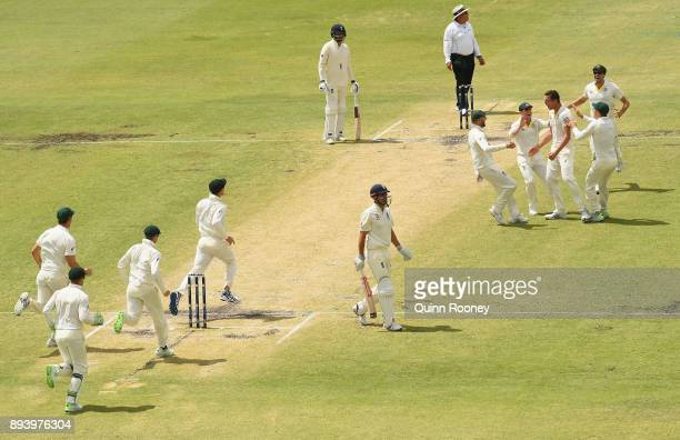Josh Hazlewood of Australia is congratulated by team mates after taking the wicket of Alastair Cook of England during day four of the Third Test...
