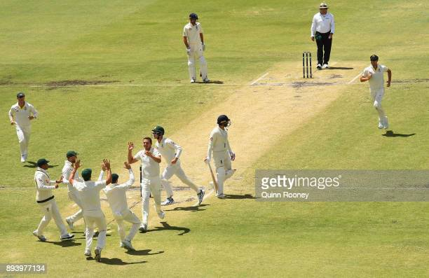 Josh Hazlewood of Australia is congratulated by team mates after taking the wicket of Mark Stoneman of England during day four of the Third Test...