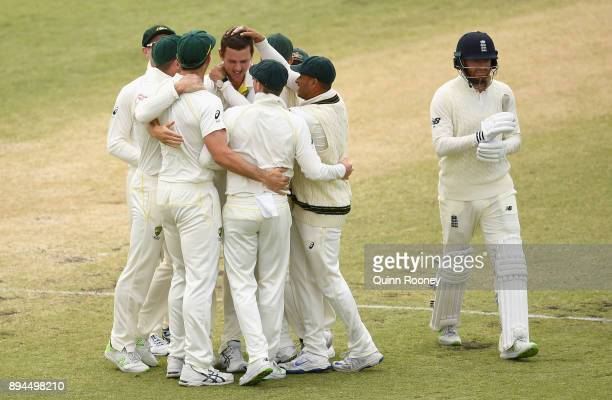 Josh Hazlewood of Australia is congratulated by team mates after taking the wicket of Jonny Bairstow of England during day five of the Third Test...