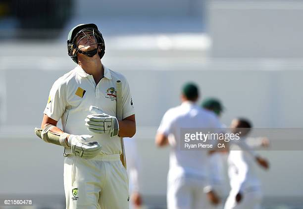 Josh Hazlewood of Australia looks dejected after being dismissed by Temba Bavuma of South Africa during day five of the First Test match between...