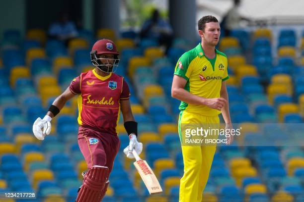 Josh Hazlewood of Australia looks to the boundary as Shai Hope of West Indies run during the 3rd and final ODI between West Indies and Australia at...