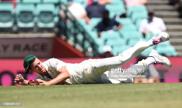Josh Hazlewood of Australia runs out Hanuma Vihari of India during day three of the third Test match between Australia and India at Sydney Cricket...