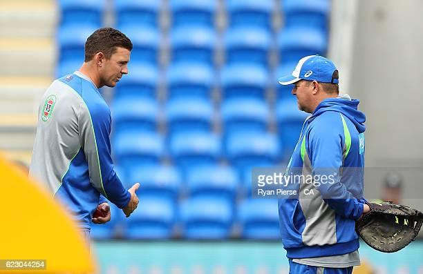 Josh Hazlewood of Australia speaks to Australian bowling coach David Saker looks on during day three of the Second Test match between Australia and...