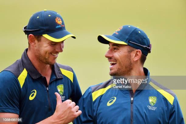 Josh Hazlewood of Australia talks with Marcus Stoinis of Australia during an Australian ODI training session/press conference at Park 25 on November...