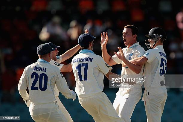 Josh Hazlewood of the Blues celebrates after taking the wicket of Marcus Harris of the Warriors during day two of the Sheffield Shield match between...