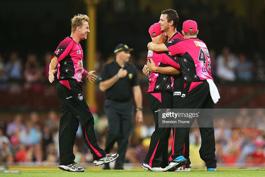 Josh Hazlewood of the Sixers celebrates with team mates after claiming the wicket of Evan Gulbis of the Hurricanes during the Big Bash League match between the Sydney Sixers and the Hobart Hurricanes at SCG on January 15, 2014 in Sydney, Australia.