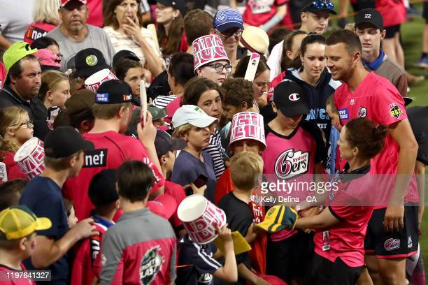Josh Hazlewood of the Sixers greets fans after the Sixers victory during the Big Bash League match between the Sydney Sixers and the Adelaide...