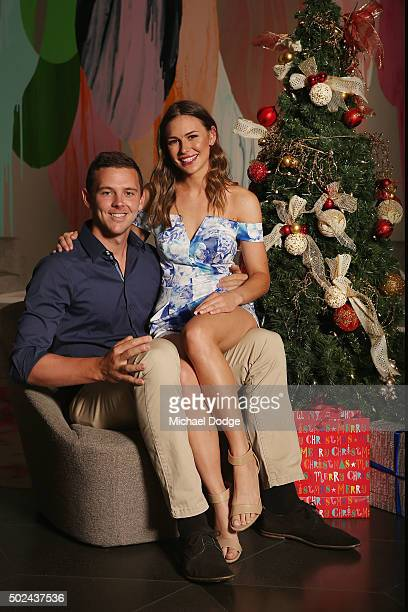 Josh Hazlewood poses with partner Cherina MurphyChristian during the Australian Test Squad Christmas Day Luncheon at Crown Entertainment Complex on...