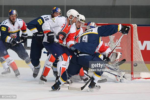 Josh Hennessy of Vaxjo and Jonathan Matsumoto of Munich during the Champions Hockey League Round of 32 match between Red Bull Munich and Vaxjo Lakers...