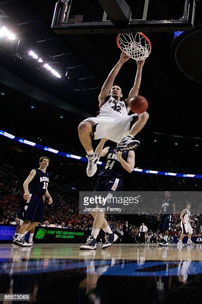 Josh Heytvelt of the Gonzaga Bulldogs dunks the ball in front of Mike Bardo of the Akron Zips in the second half during the first round of the NCAA...
