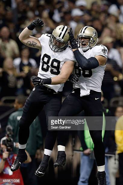 Josh Hill and Jimmy Graham of the New Orleans Saints celebrate a touchdown during the first quarter of a game against the Minnesota Vikings at the...