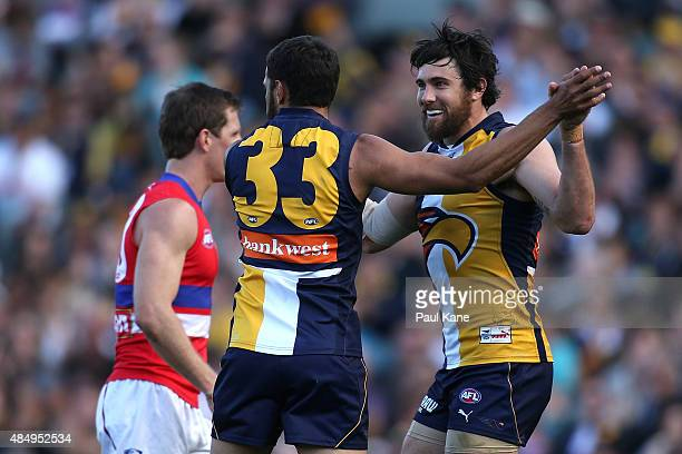 Josh Hill and Josh Kennedy of the Eagles celebrate a goal during the round 21 AFL match between the West Coast Eagles and Western Bulldogs at Domain...