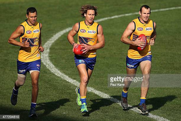 Josh Hill, Matt Priddis and Shannon Hurn of the Eagles run laps during a West Coast Eagles AFL training session at Domain Stadium on June 15, 2015 in...