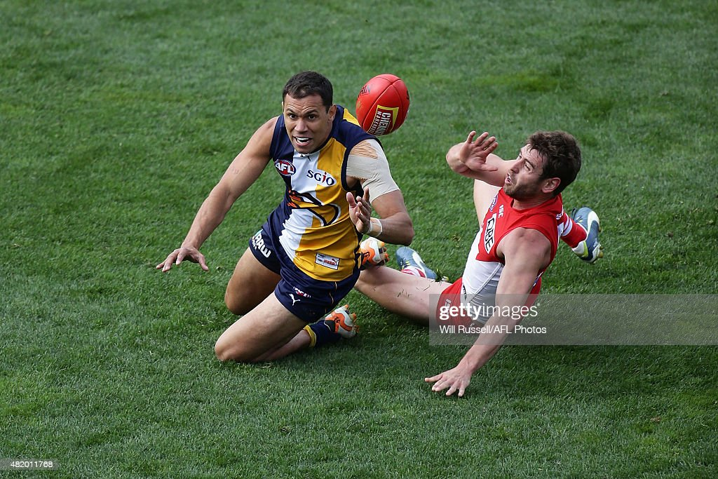 Josh Hill of the Eagles is tackled by Nicholas Smith of the Swans during the round 17 AFL match between the West Coast Eagles and the Sydney Swans at Domain Stadium on July 26, 2015 in Perth, Australia.
