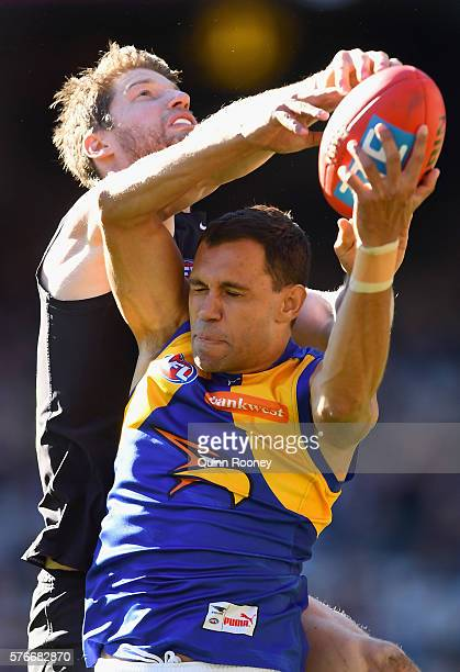 Josh Hill of the Eagles marks infront of Sam Rowe of the Blues during the round 17 AFL match between the Carlton Blues and the West Coast Eagles at...