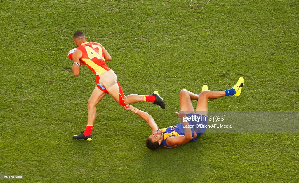 Josh Hill of the Eagles tackles Adam Saad of the Suns during the round 11 AFL match between the Gold Coast Suns and the West Coast Eagles at Metricon Stadium on June 3, 2017 in Gold Coast, Australia.