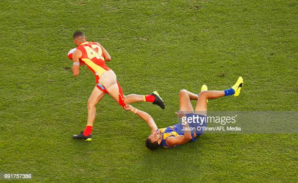 Josh Hill of the Eagles tackles Adam Saad of the Suns during the round 11 AFL match between the Gold Coast Suns and the West Coast Eagles at Metricon...