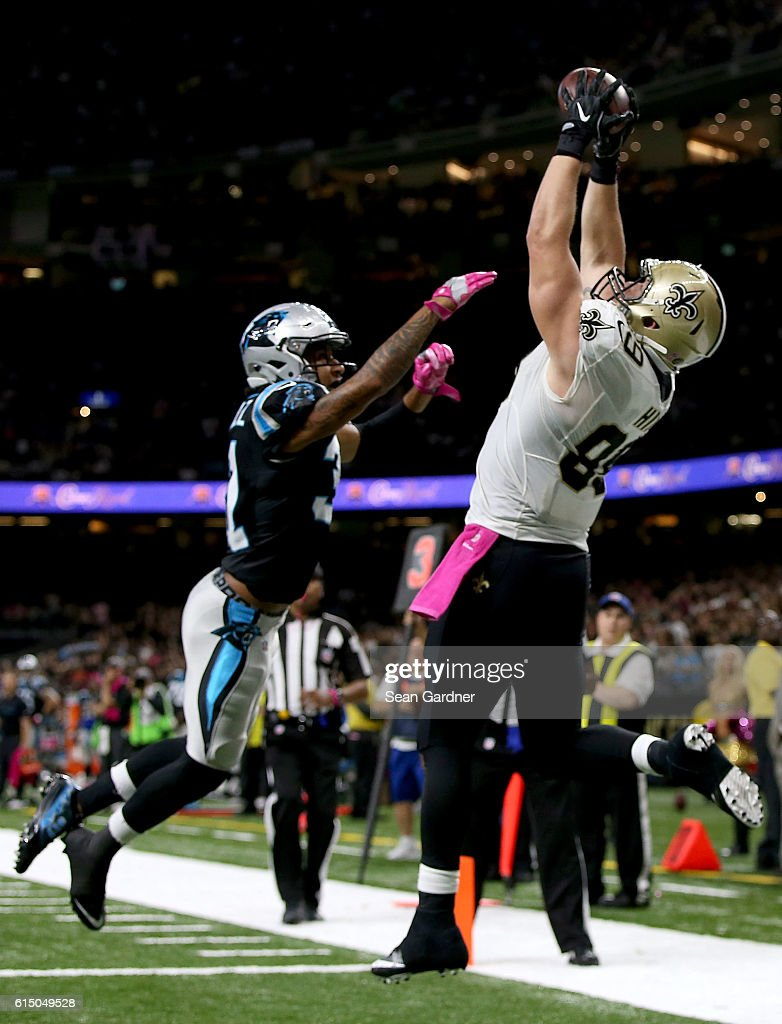 Josh Hill #89 of the New Orleans Saints catches a touchdown pass over Zack Sanchez #31 of the Carolina Panthers during the fourth quarter at the Mercedes-Benz Superdome on October 16, 2016 in New Orleans, Louisiana.
