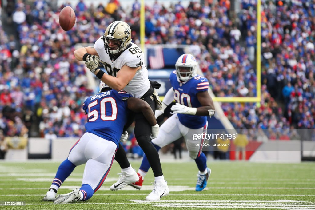 Josh Hill #89 of the New Orleans Saints fumbles the ball as he is hit by Ramon Humber #50 of the Buffalo Bills during the second quarter on November 12, 2017 at New Era Field in Orchard Park, New York.
