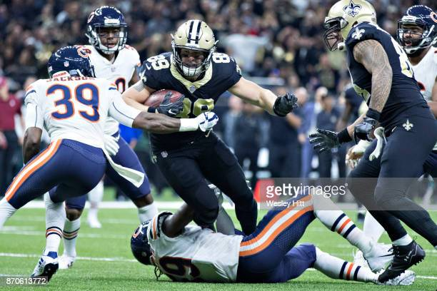 Josh Hill of the New Orleans Saints runs the ball after catching a pass and is tackled by Eddie Jackson of the Chicago Bears at MercedesBenz...