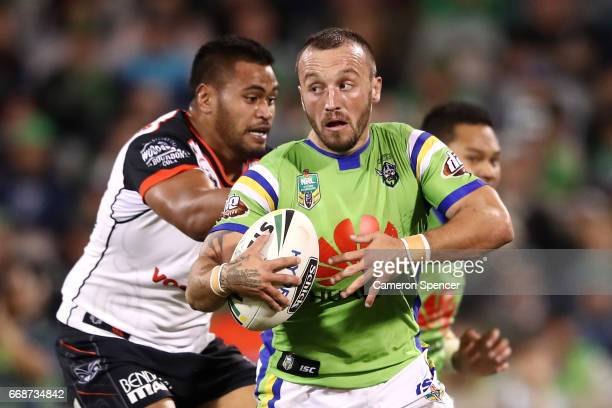 Josh Hodgson of the Raiders is tackled during the round seven NRL match between the Canberra Raiders and the New Zealand Warriors at GIO Stadium on...