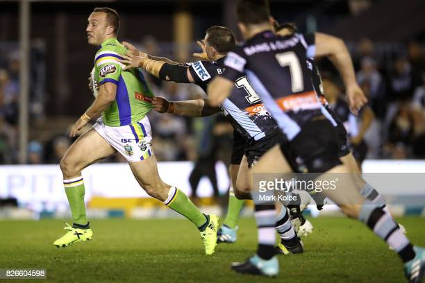 Josh Hodgson of the Raiders looks for support after making a break during the round 22 NRL match between the Cronulla Sharks and the Canberra Raiders...