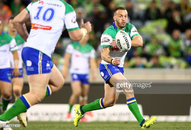 Josh Hodgson of the Raiders passes during the round 25 NRL match between the Canberra Raiders and the Newcastle Knights at GIO Stadium on August 25...