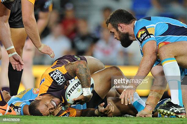 Josh Hoffman of the Broncos grimaces after being tackled during the round 6 NRL match between the Gold Coast Titans and the Brisbane Broncos at Cbus...